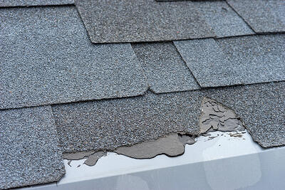 fixing shingles that blow off